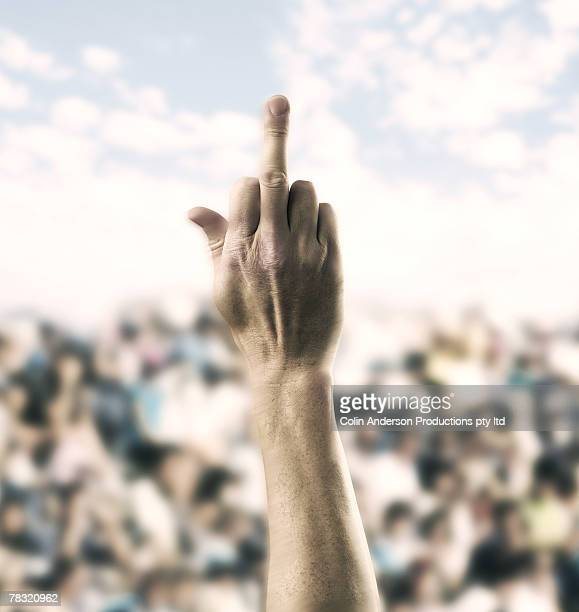person showing middle finger to crowd - middle finger funny stock photos and pictures