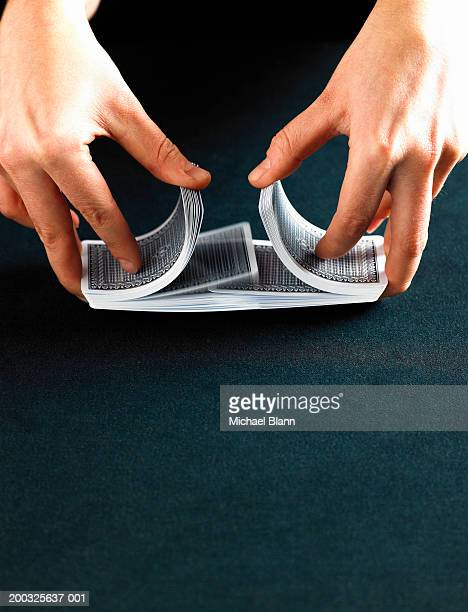person shuffling deck of cards, close-up - shuffling stock photos and pictures