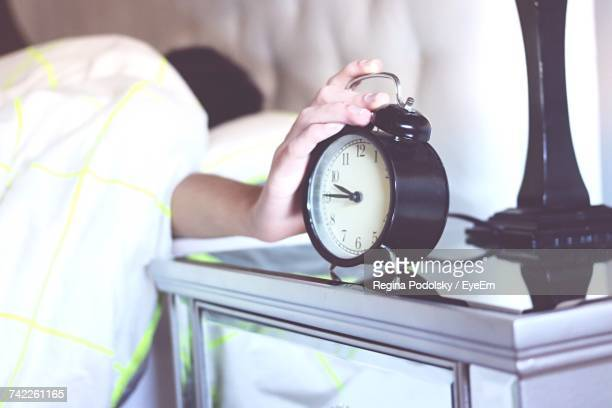 Person Shutting Of Morning Alarm Clock