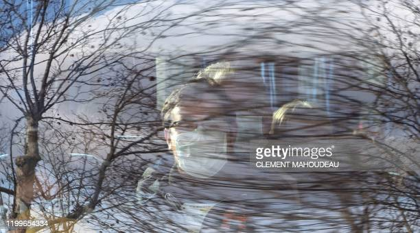 A person sits in the bus with others European citizens flown out from the coronavirus zone in Wuhan China as they arrives at the Ensosp where they...