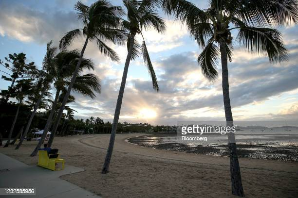 Person sits on a bench at the lagoon at Airlie Beach during sunset in the Whitsundays, Queensland, Australia, on Tuesday, April 27, 2021. The...
