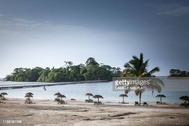 A person sits on a chair on the artificial beach of the Sofitel Hotel in Sipopo nearly 16km from Malabo in Equatorial Guinea on April 20 2019 In...