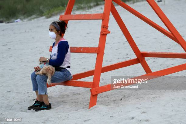 A person sits on a lifeguard chair on April 19 2020 in Jacksonville Beach Florida Jacksonville Mayor Lenny Curry announced Thursday that Duval...