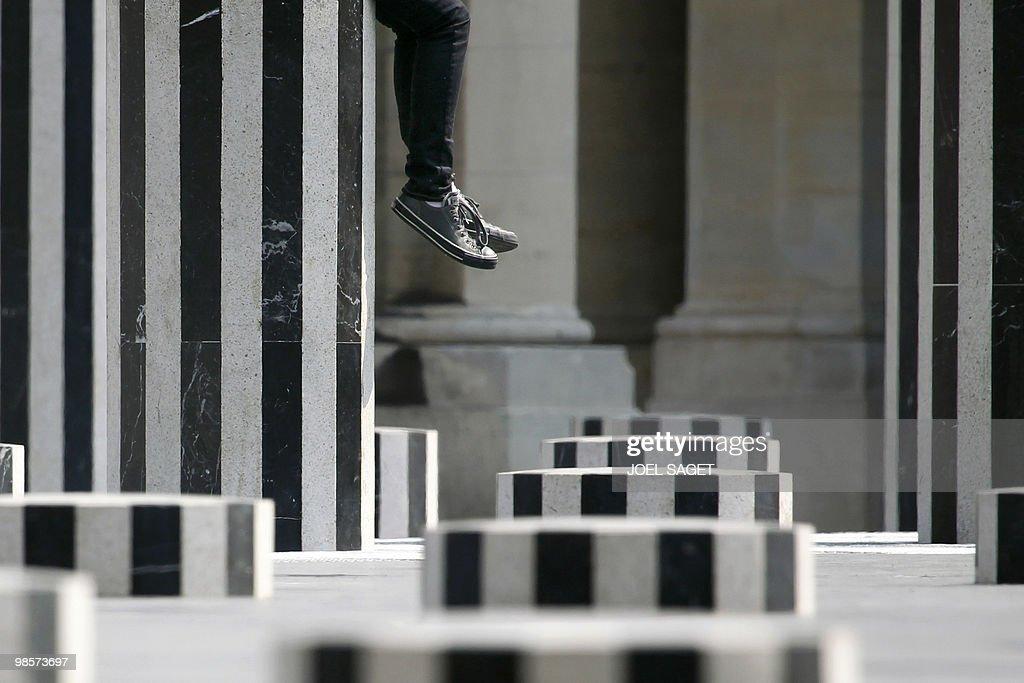 A person sits on the Daniel Buren column : News Photo