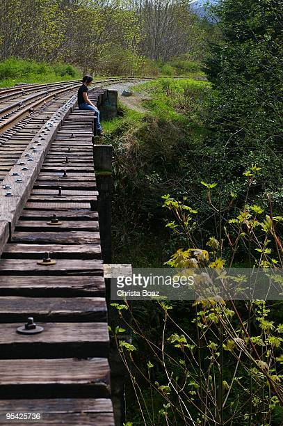 person sitting alone in a railway - suicide stock photos and pictures