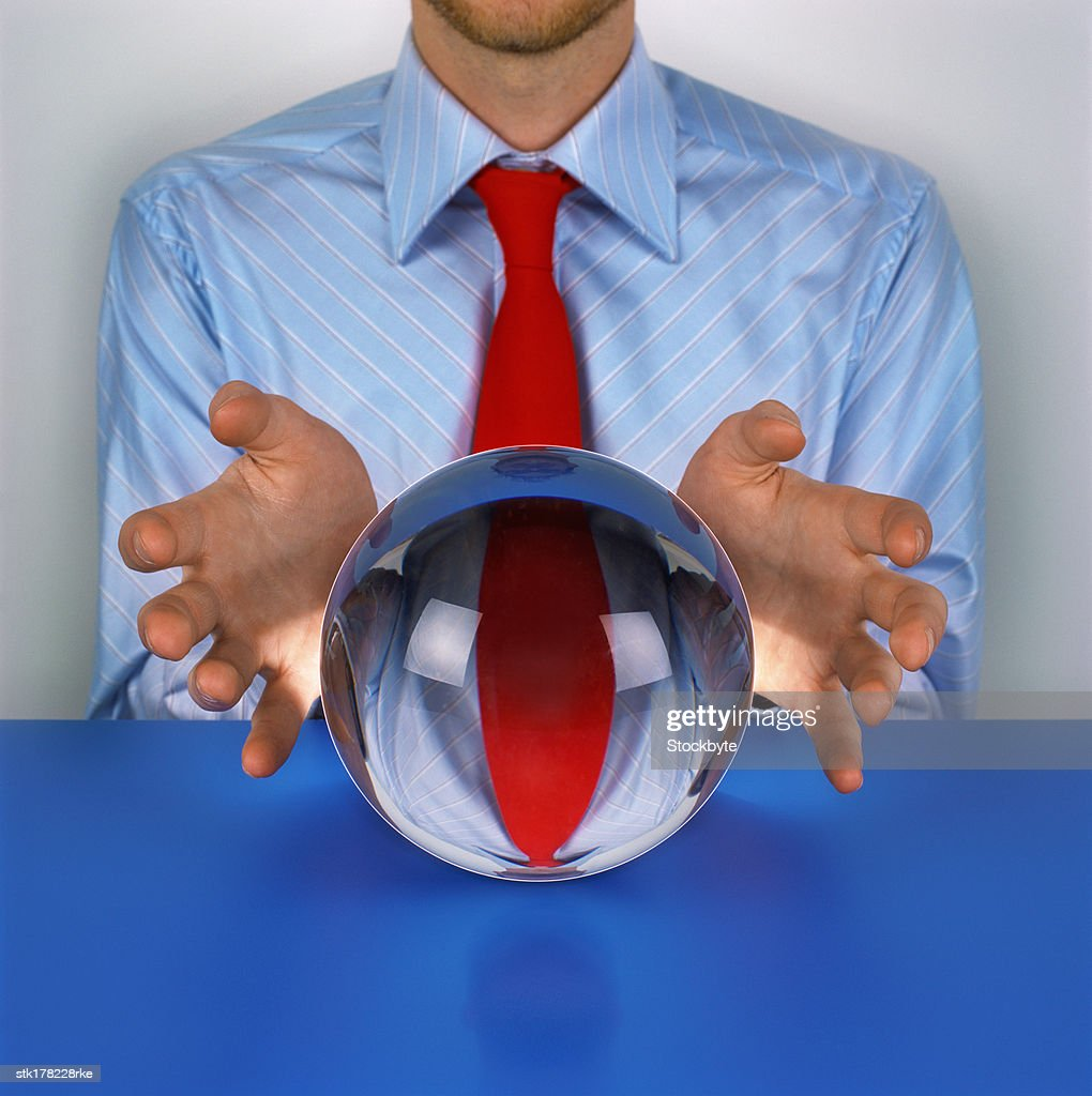 person sitting in front of a crystal ball : Stock Photo