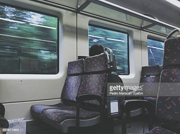 Person Sitting In Moving Train