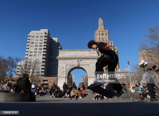 Person skateboards in the fountain area in Washington Square Park on March 13, 2021 in New York City.
