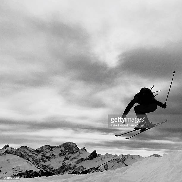 Person Skiing Against Cloudy Sky