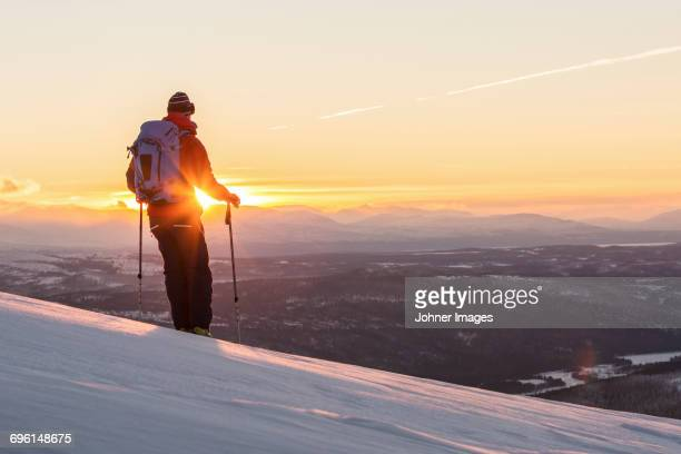 Person skiing at sunset