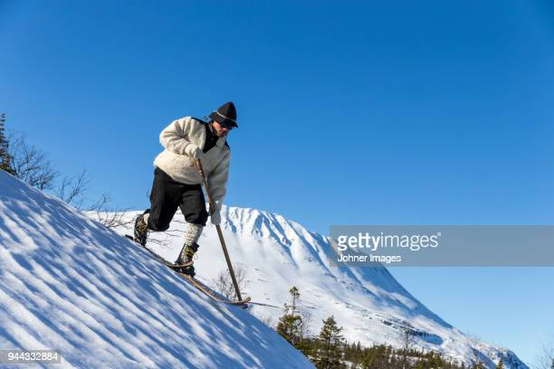 person skiing in traditional clothing - telemark stock pictures, royalty-free photos & images