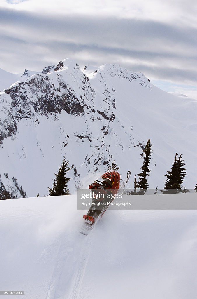 Person Sledding in Coast Mountain, British Columbia, Canada : Stock Photo