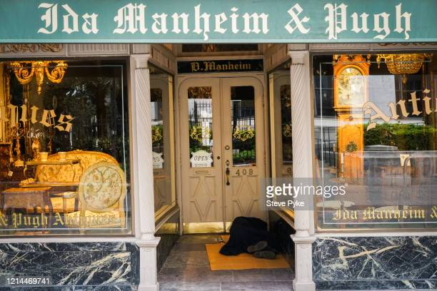 A person sleeping in the doorway of an antique shop in the French Quarter of New Orleans amid restrictions in place to help deal with the Covid19...