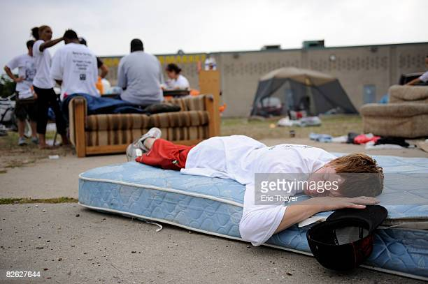 A person sleeps at Bushville where many out of town protesters are staying near the Xcel Center the site of the 2008 Republican National Convention...