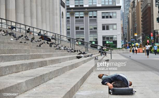 A person sleeps near Penn Station by Madison Square Gardens on September 17 2020 in New York City
