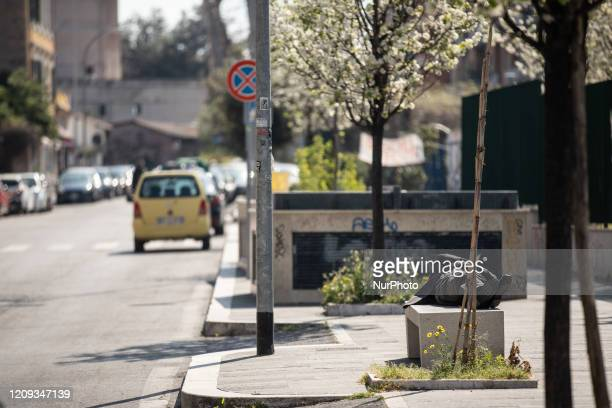 A person sleeps on a bench in broad daylight In the background a normally busy road which due to the lockdown appears deserted on April 7 2020 in...