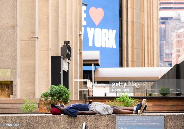 A person sleeps outside the Madison Square Garden as the city continues Phase 4 of reopening following restrictions imposed to slow the spread of...