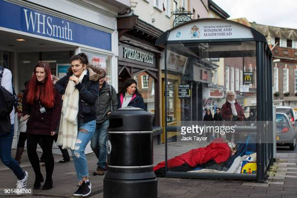 A person sleeps rough in a bus shelter outside Windsor Castle on January 5 2018 in Windsor England British Prime Minister Theresa May has publicly...