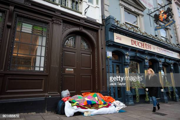 A person sleeps rough in a doorway opposite Windsor Castle on January 5 2018 in Windsor England British Prime Minister Theresa May has publicly...