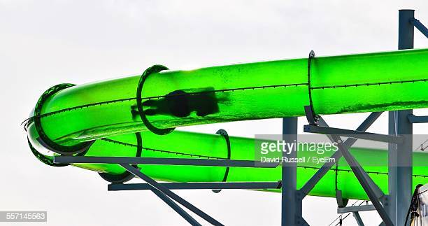 Person Sliding Inside Green Tube