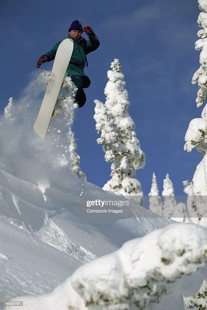 Person snowboarding : Stockfoto