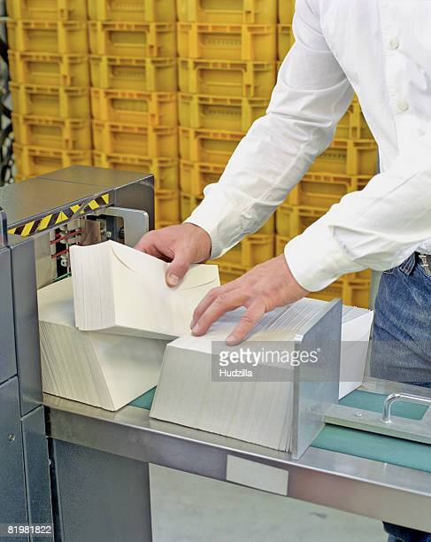 A person sorting mail