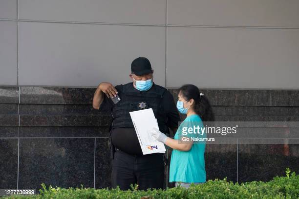 Person speaks to a security guard outside of the Chinese consulate after the United States ordered China to close its doors on July 22, 2020 in...