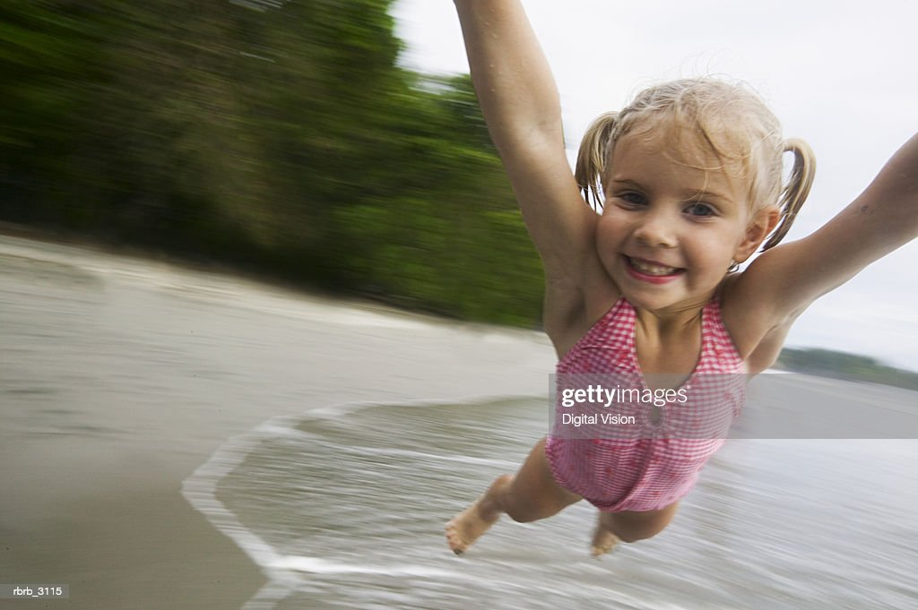 Person spinning a girl on the beach : Foto de stock