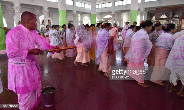 A person sprays coloured water as people take part in the Yaosang festival in Govindagee Temple in Imphal in northeastern Manipur state on March 13...