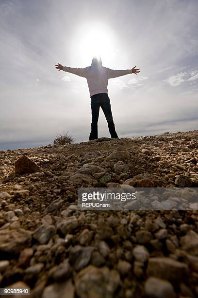 Person Standing Arms Outstretched