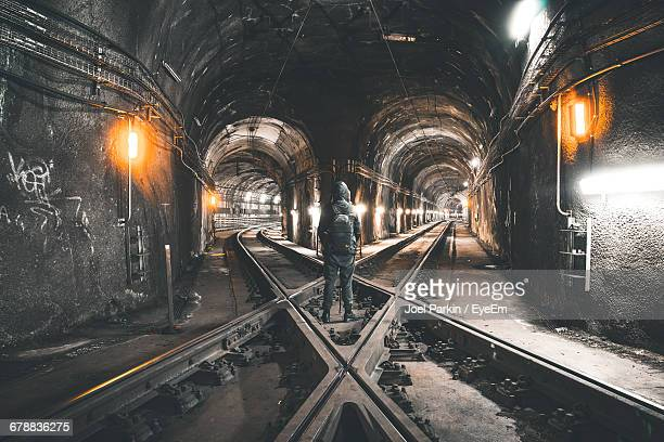 Person Standing At Railroad Track