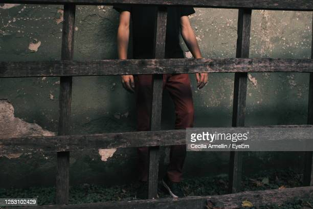 person standing by railing against building - buenos aires stock pictures, royalty-free photos & images