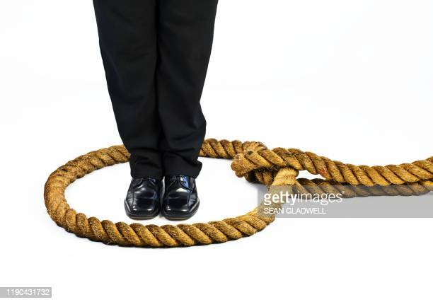 person standing in rope noose - execution stock pictures, royalty-free photos & images