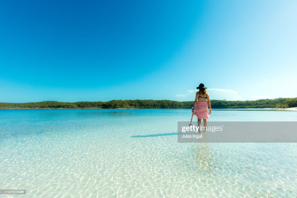 Person standing in the water looking out : ストックフォト