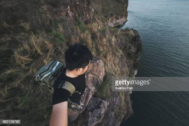 Person Standing On Cliff Edge