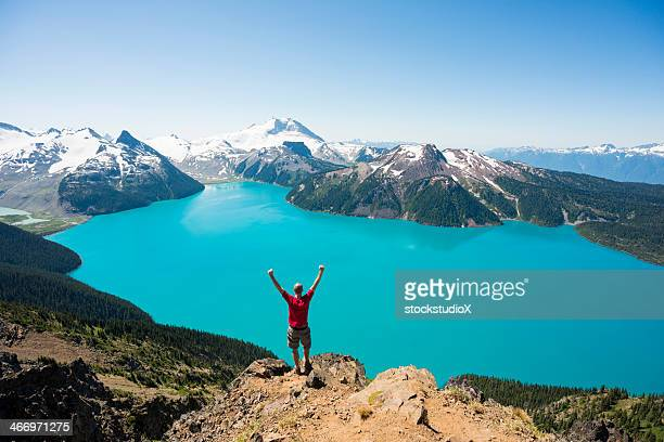 person standing on cliff enjoy beautiful view of nature - garibaldi park stock pictures, royalty-free photos & images