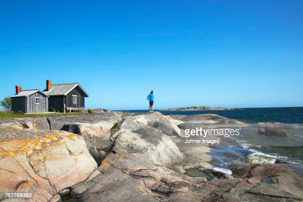 Person standing on rocky coast