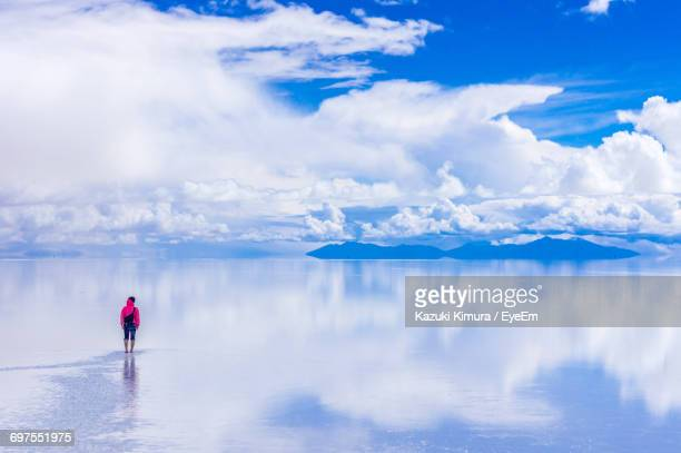 person standing on salt flat against sky - bolivia stockfoto's en -beelden