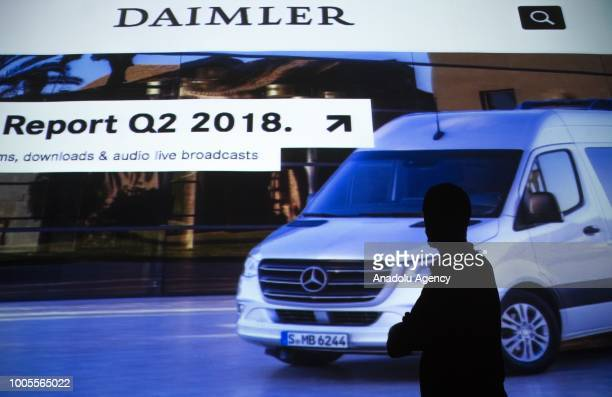 A person stands in front of a projector showing the website of Daimler AG in Ankara Turkey on July 26 2018