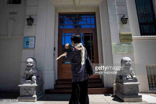 Person stands in front of the Consulate General of the People's Republic of China in San Francisco, California on July 23, 2020. - The US Justice...