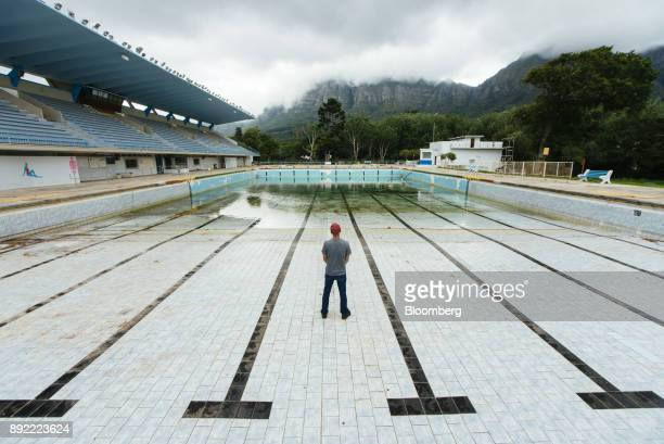A person stands in the pool to demonstrate the severely low water level at the Newlands municipal swimming pool in Cape Town South Africa on Monday...