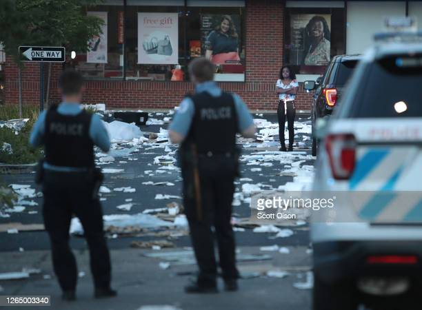 A person stands near a looted store after parts of the city had widespread looting and vandalism on August 10 2020 in Chicago Illinois Police made...