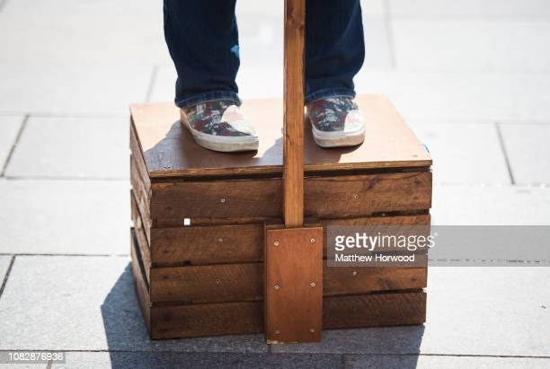 A person stands on a traditional soapbox while making a political speech on June 2 2018 in Cardiff United Kingdom
