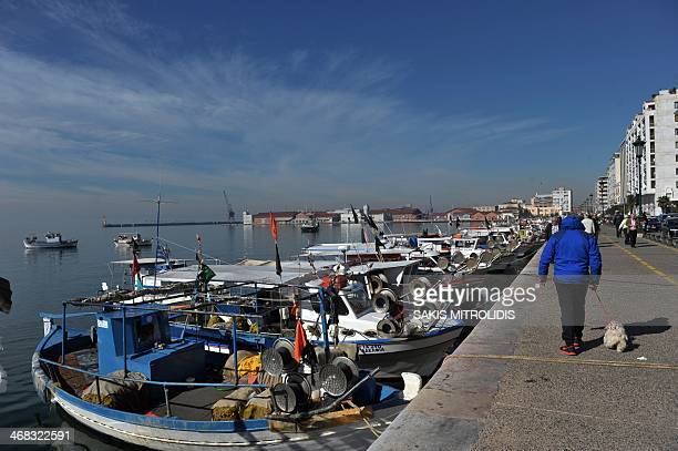 A person stands on the boardwalk as hundreds of fishermen with sailboats sailed in Thermaikos Gulf to protest against the ban fishing for cod with...