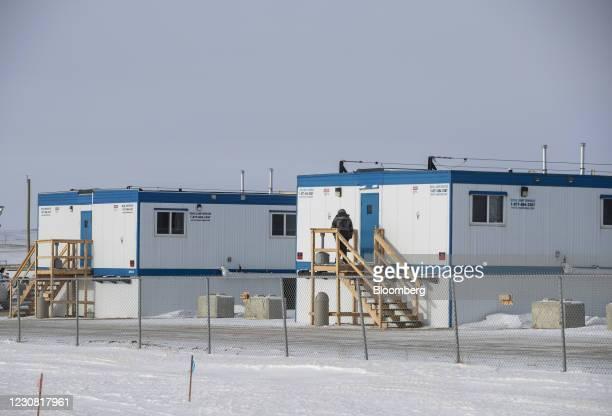 Person stands outside a work camp for the Keystone XL pipeline in Oyen, Alberta, Canada, on Tuesday, Jan. 26, 2021. U.S. President Joe Biden...