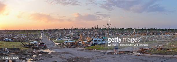 Person surveys damage one day after a tornado tore through Joplin killing at least 122 people on May 23, 2011 in Joplin, Missouri. The tornado that...