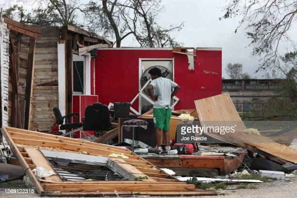 Person surveys what is left of a barber shop after Hurricane Laura passed through the area on August 27, 2020 in Lake Charles, Louisiana . The...