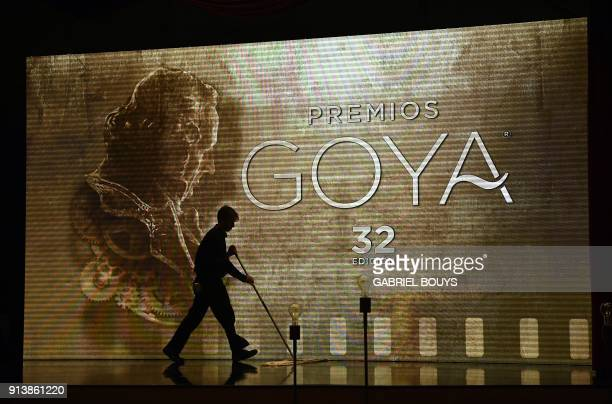 A person sweeps the stage before the 32nd Goya awards ceremony in Madrid on February 3 2018 / AFP PHOTO / GABRIEL BOUYS
