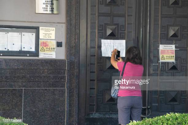 Person takes a photo of a notification paper outside of the Chinese consulate after the United States ordered China to close its doors on July 22,...