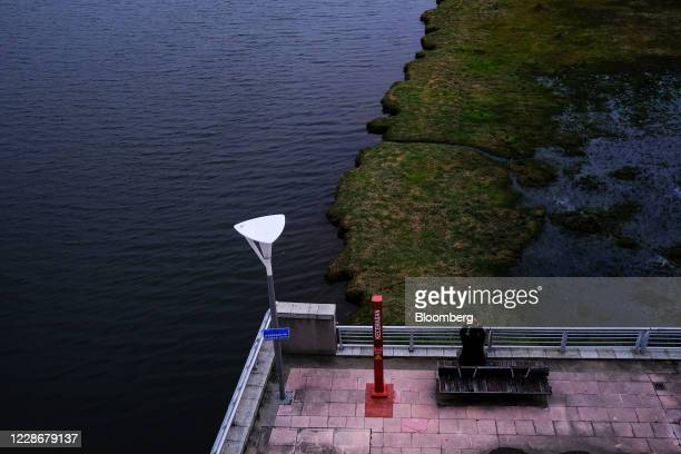 A person takes a photograph of Putrajaya Lake in Putrajaya Malaysia on Wednesday Sept 23 2020 Malaysia's Prime Minister Muhyiddin Yassin urged people...